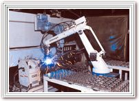 Welder with material-handling robot